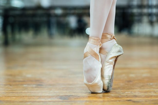 Cropped image of a female ballet dancer standing on toes